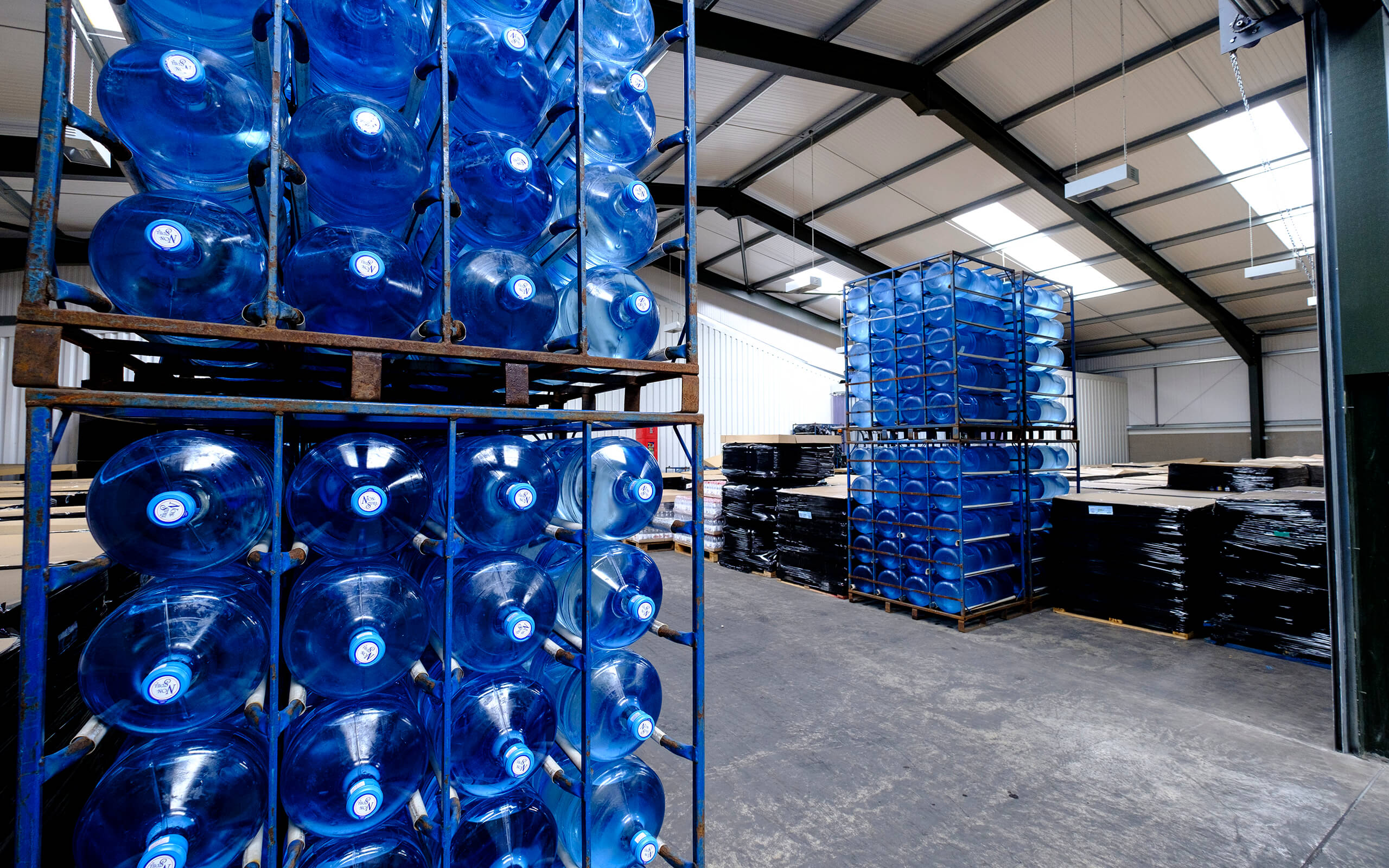 National Springwater crates - blue water bottes stacked.