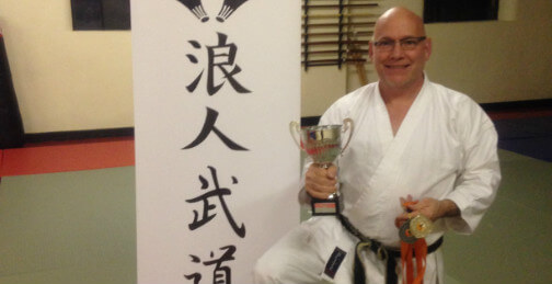 Charles Spring with karate trophies