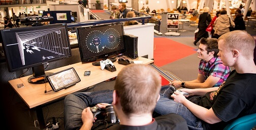 Students playing games developed by derby students