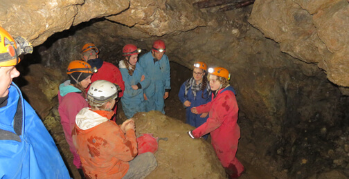 Buxton rotary students in a cave