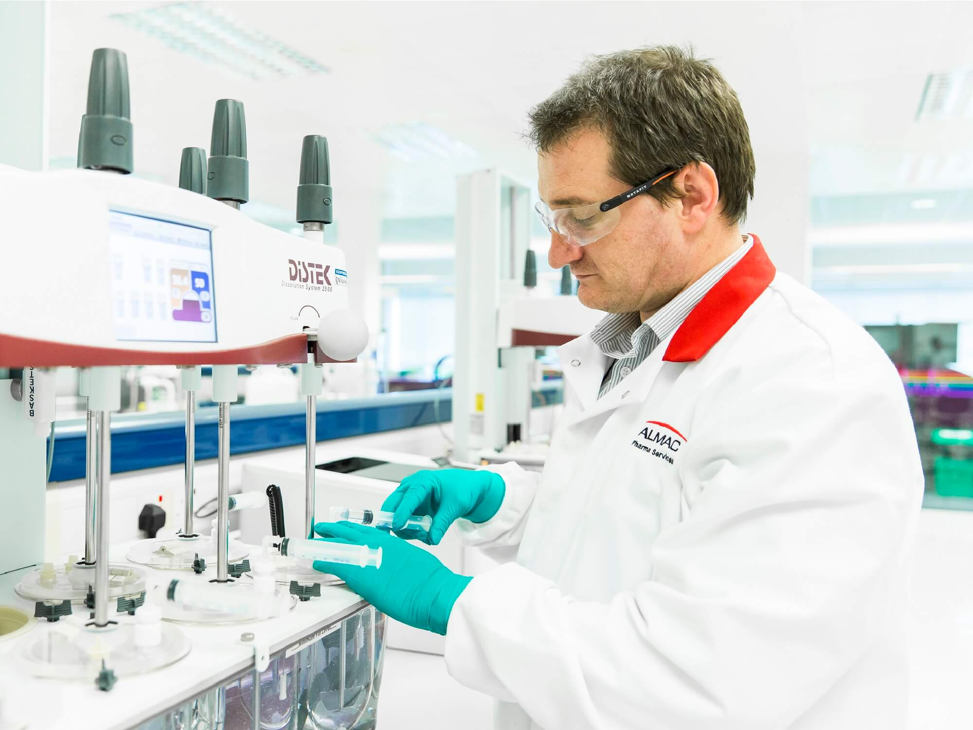 Someone working in a lab at Almac Pharma Services