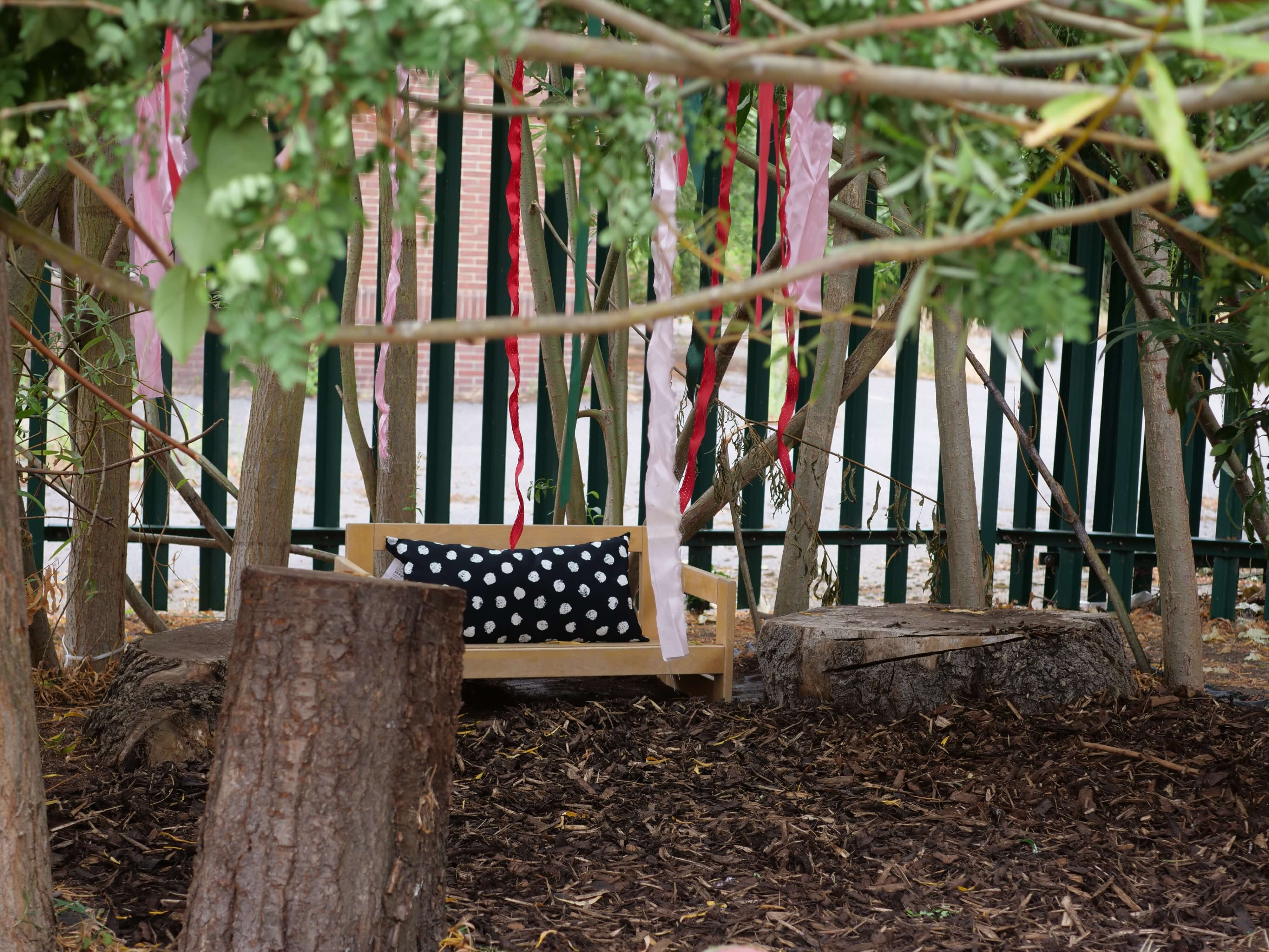 Derwent Stepping Stones Childcare forest garden with ribbon streamers and wooden bench
