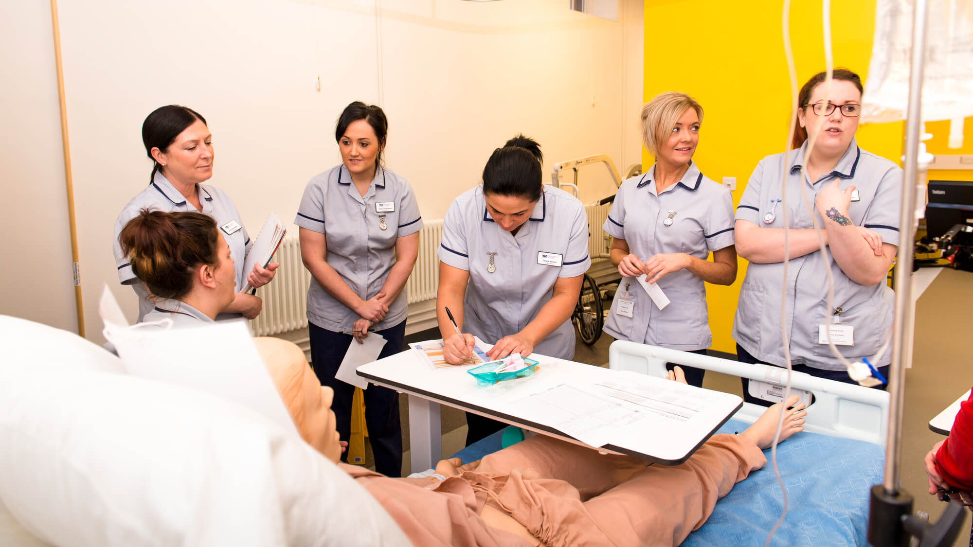 Student nurses study in ward facility