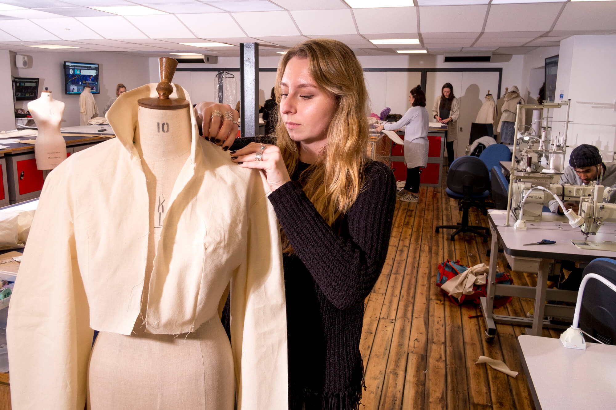 A fashion student working in our textiles studios