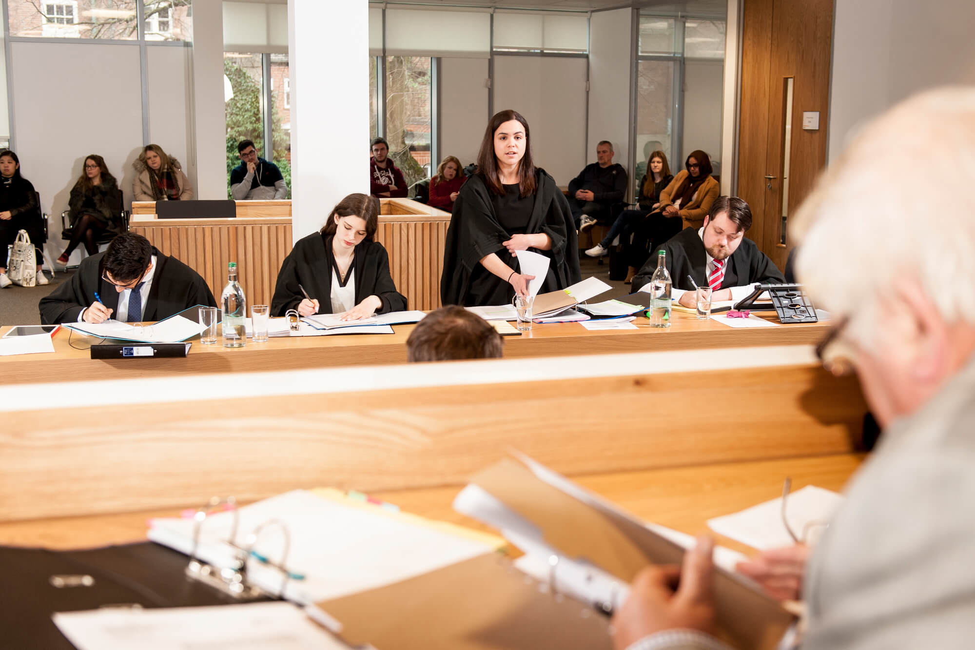 Students practise arguing in front of a judge in moot court