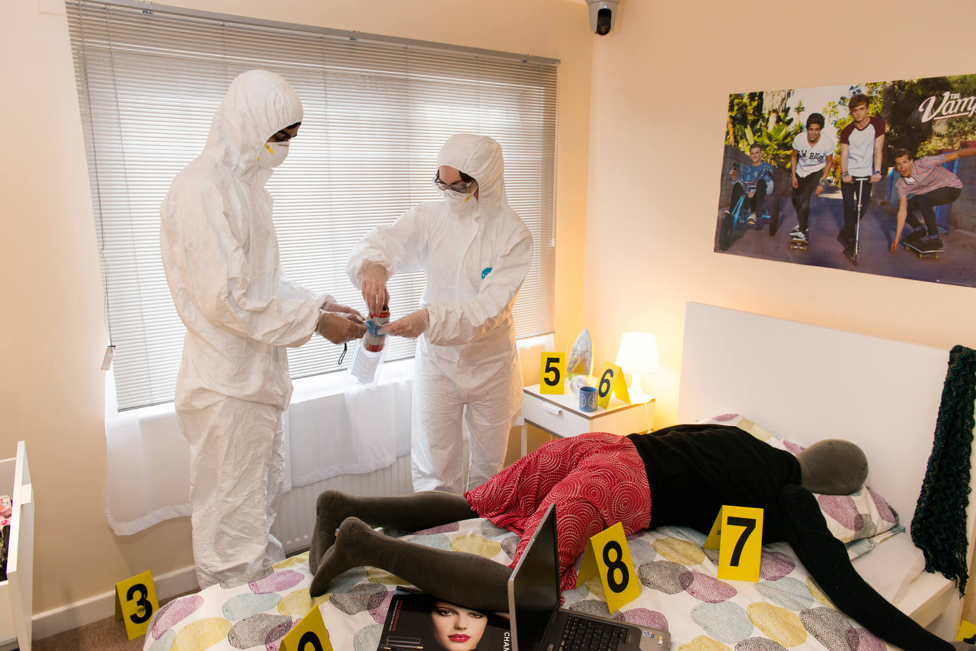 Students reviewing crime scene in Forensic Training Facility