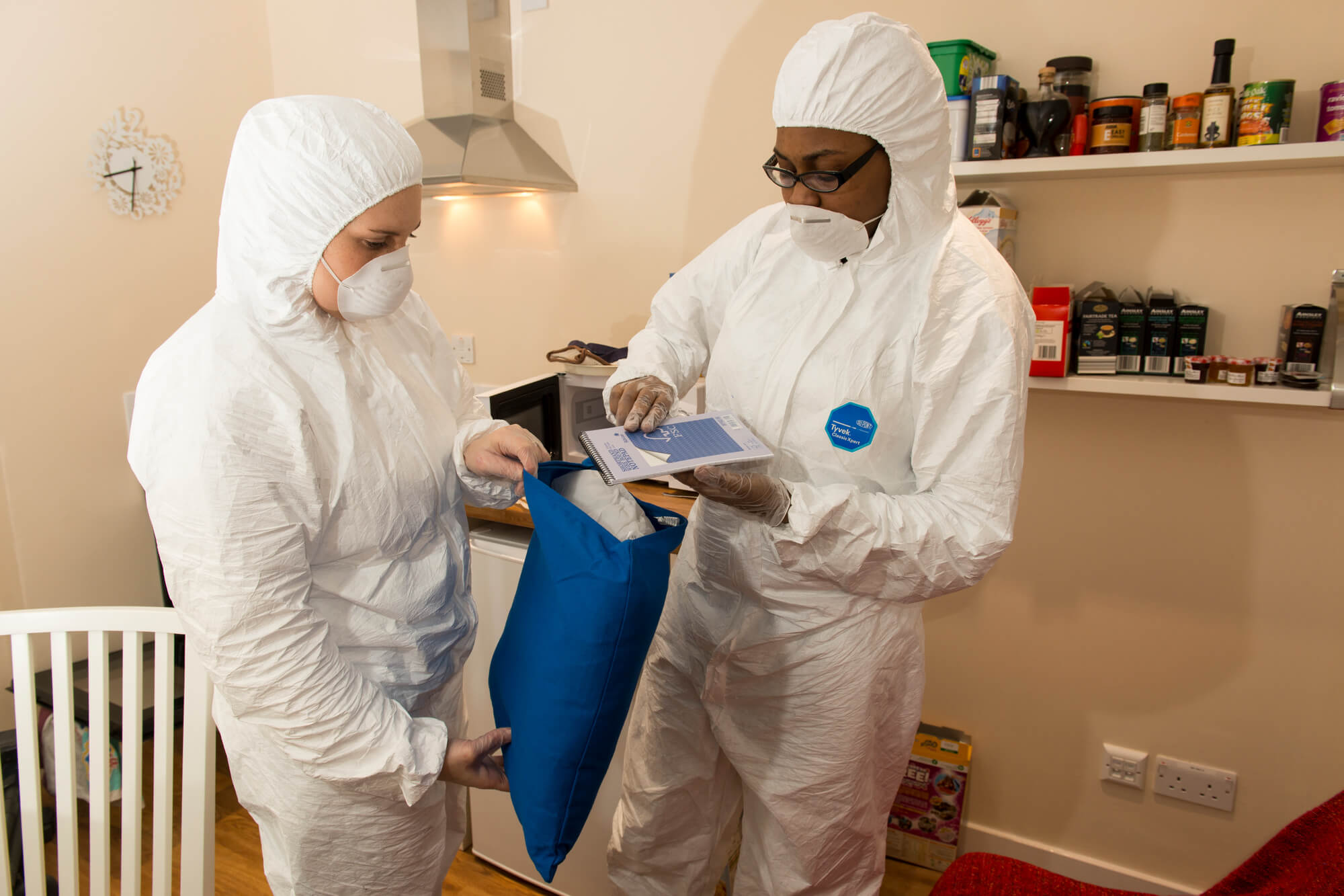 Students bagging up evidence during a practical session in the Forensic Training Facility