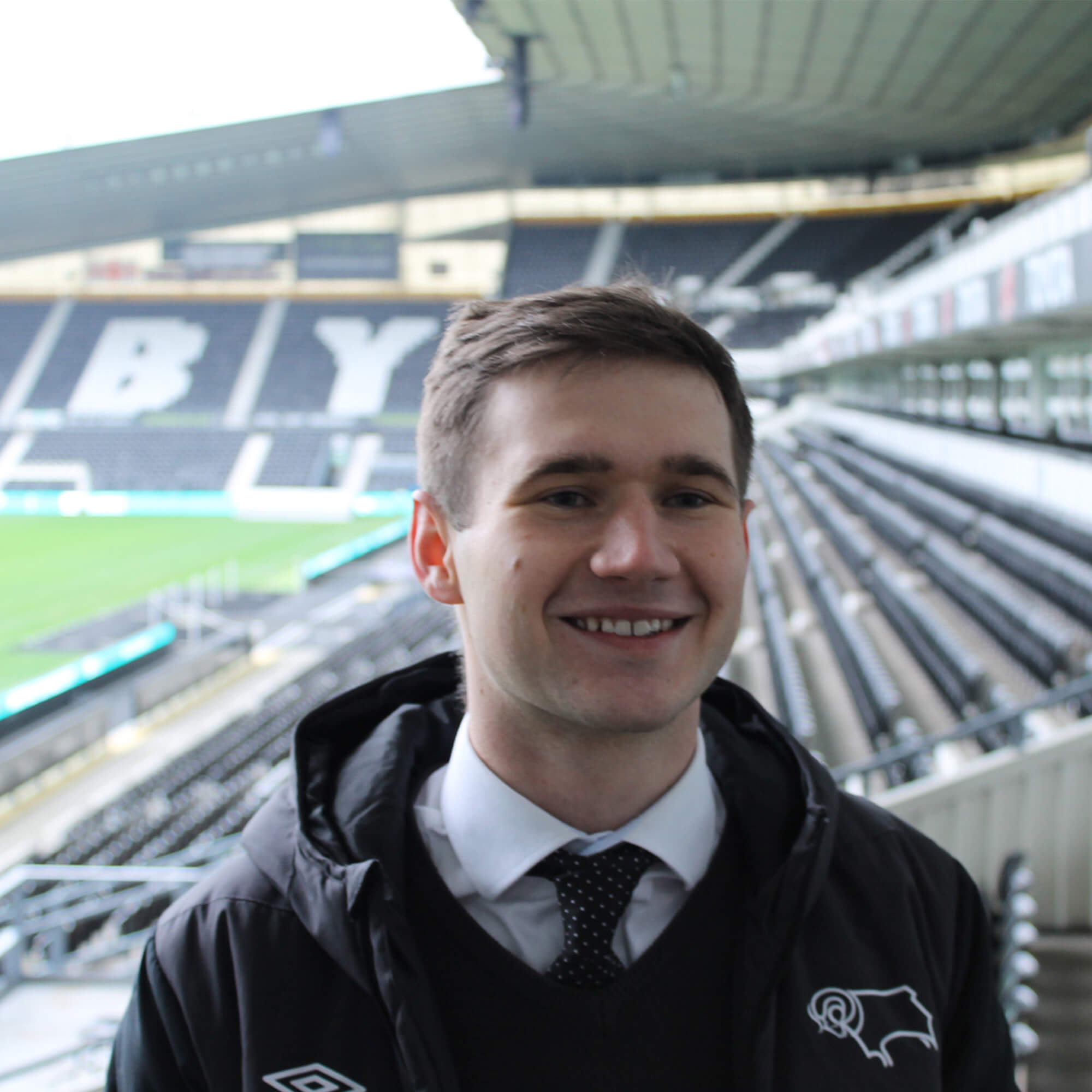 Student smiling at the Derby County Footfall Club grounds