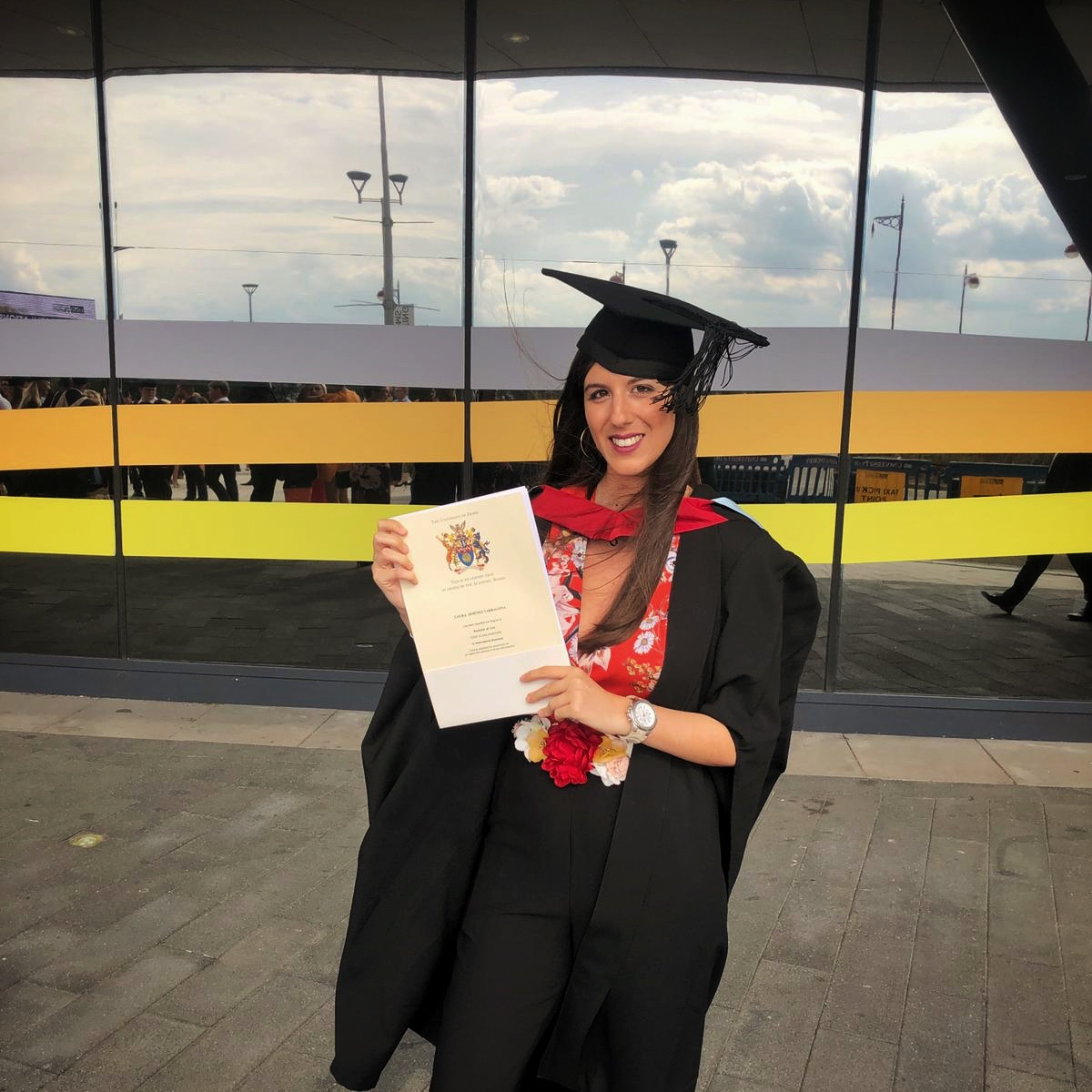 Photo of business student at graduation outside Derby Arena