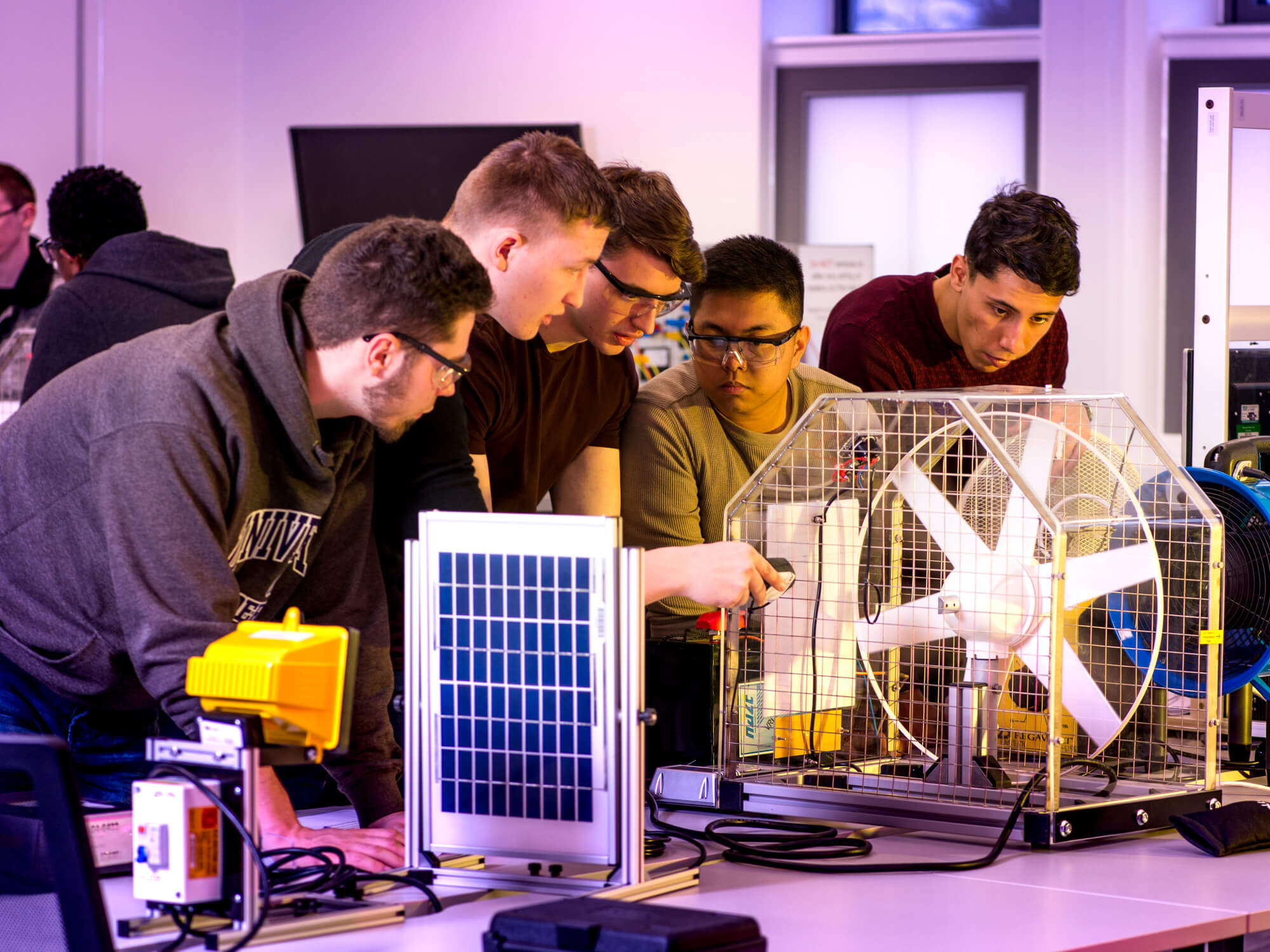 Electrical and Electronic Engineering students using renewable energies equipment