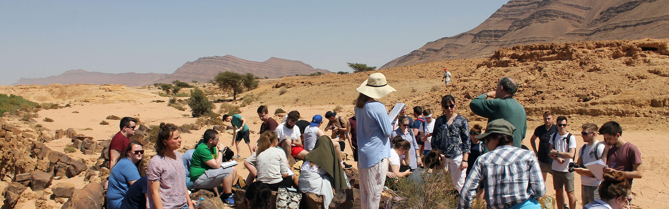 Group of students working in the desert on Morocco fieldtrip