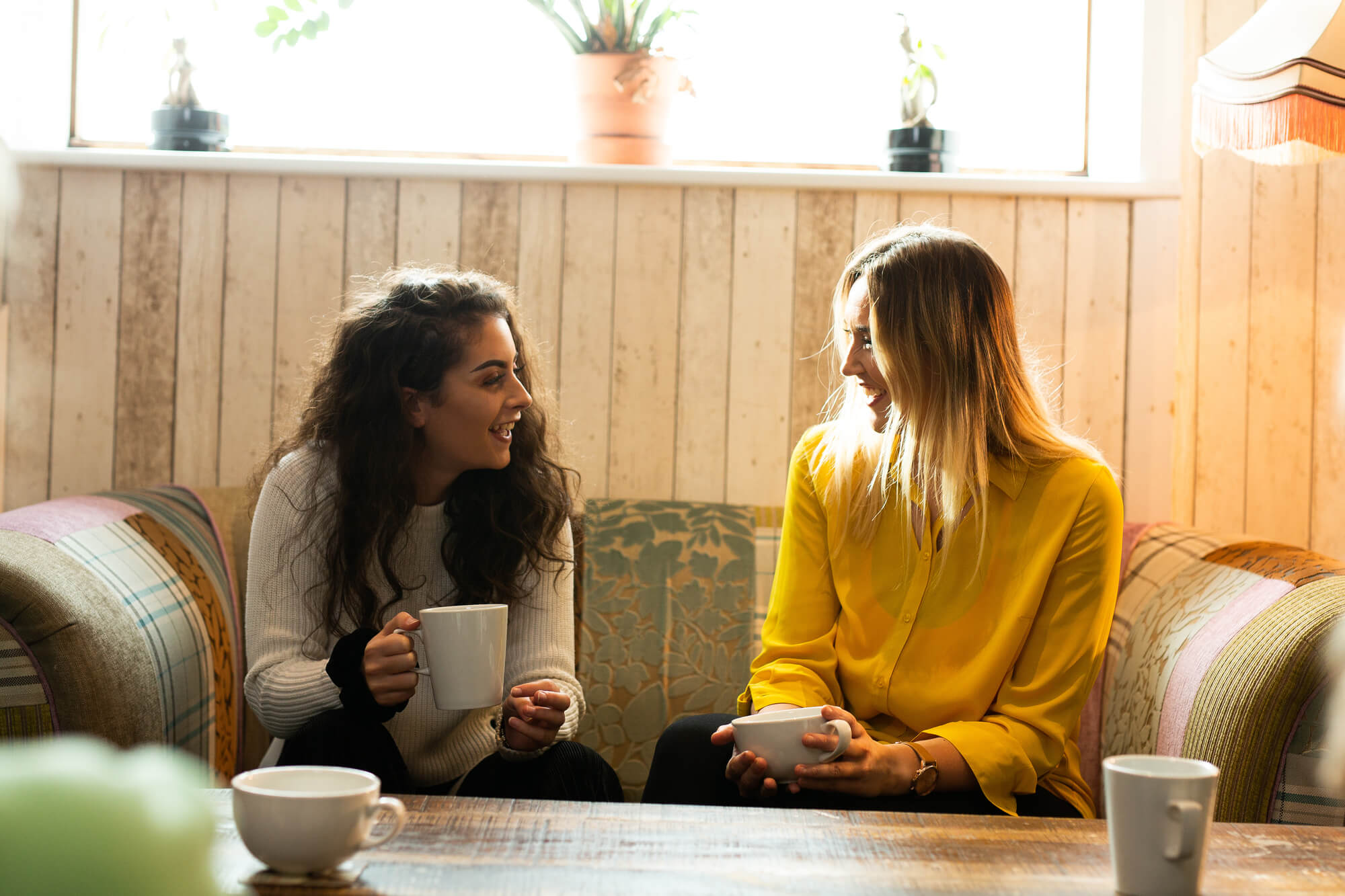A smiling student socialising in Blends coffee shop
